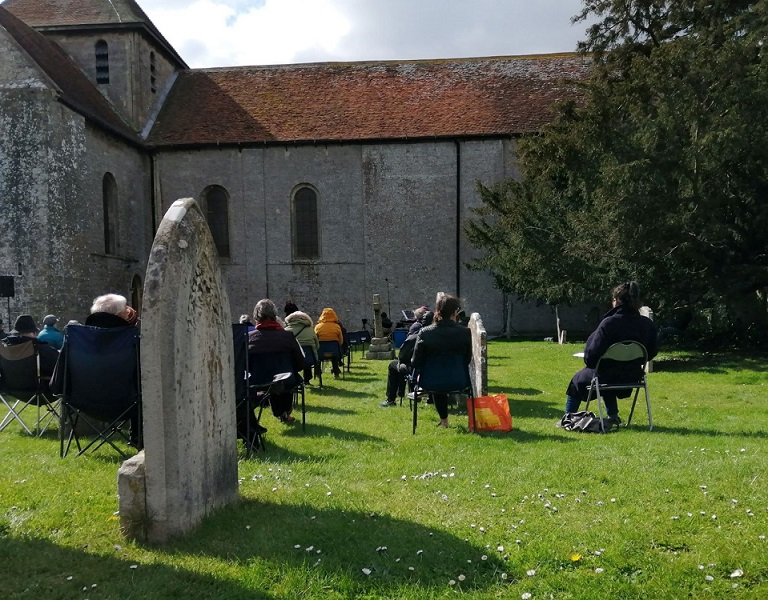 Congregation outside church