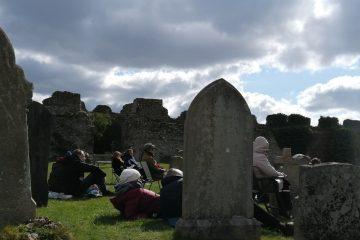 Congregation in a graveyard