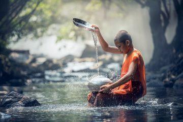 Buddhist boy in water