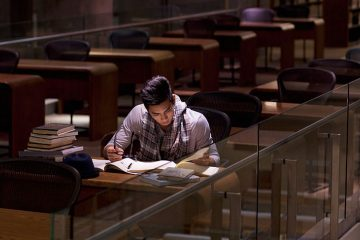 Boy studying in empty library