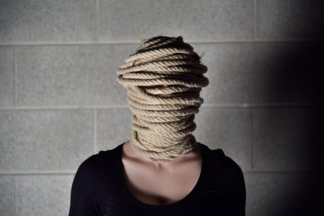 Person with rope around their head